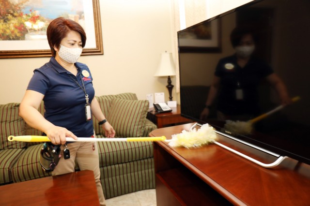 Maria Devera, housekeeping leader, prepares a room for new guests at Camp Zama Army Lodging, Camp Zama, Japan, April 28.