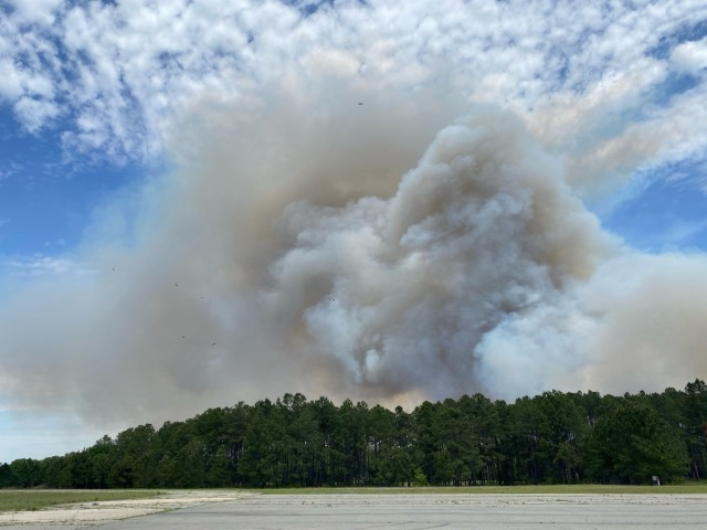 A smoke plume covers the horizon following a controlled burn, April 23 on Fort Stewart, Georgia. A large smoke plume hap-pens from several small fires burning together quickly to form a large fire.