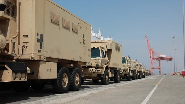 Military vehicles are stationed in a row after offload from the Liberty Peace cargo vessel at the industrial port of Yanbu, Kingdom of Saudi Arabia April 20, 2021. They will be transported back to Kuwait as part of logistics Exercise, LOGEX21. The military vehicles included the M2/A2 Bradley Fighting Vehicle, Light Medium Tactical Vehicles (LMTV), and the High Mobility Multipurpose Wheeled Vehicle (HMMWV). LOGEX 21 demonstrates the 1st Theater Sustainment Command's readiness and ability to provide responsive support to U.S. and partner nation forces from anywhere in the U.S. Central Command theater, exercising the Trans-Arabian Network. (U.S. Army photo by Capt. Elizabeth Rogers)