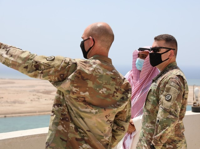 Col. Michael Ludwick, commander of the 595th Transportation Brigade (SDDC) and Lt. Col. Andrew Kocsis, commander of the 840th Transportation Battalion (SDDC), receive a tour of the commercial port at Yanbu, Kingdom of Saudi Arabia, from Mr. Rami Ahmed Alshmrani, Prince Abdulmohsin Bin Abdulaziz Airport Operations Director, ahead of the arrival of the Liberty Peace cargo vessel as part of logistics exercise, LOGEX 21, April 19, 2021. LOGEX 21 demonstrates the 1st Theater Sustainment Command's readiness and ability to provide responsive support to U.S. and partner nation forces from anywhere in the U.S. Central Command theater, exercising the Trans-Arabian Network.   (U.S. Army photo by Capt. Elizabeth Rogers)