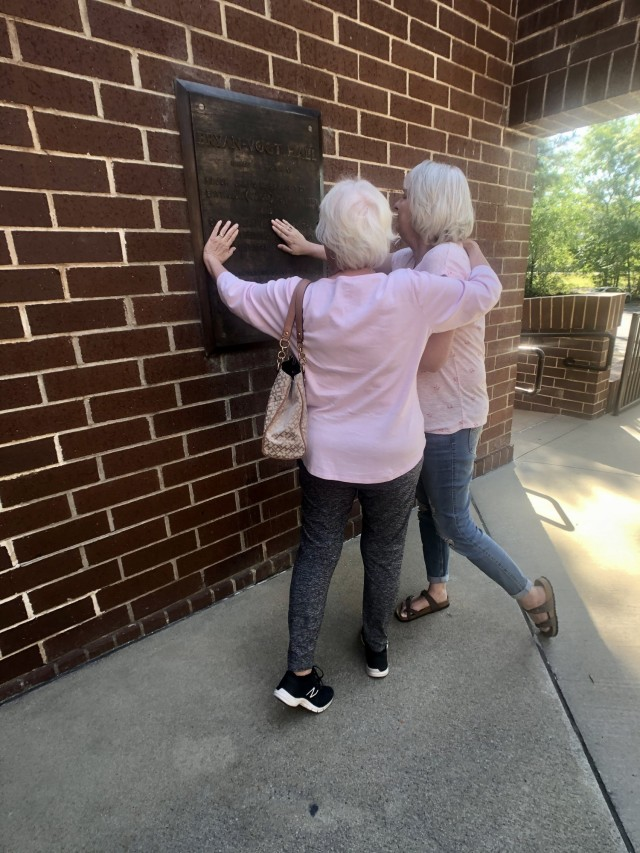 Gold Star Spouse Nancy Jacobs and daughter Kristy Drews observe the memorial plaque placed outside Bryan-Vogt Hall, April 22 on Fort Stewart.