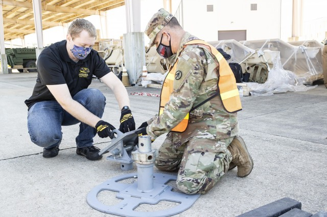 A Solider from the 757th Expeditionary Rail Center works with a civilian employee from the U.S. Army Engineer Research and Development Center to configure a landing beam during a RAIL demonstration at Anniston Army Depot.