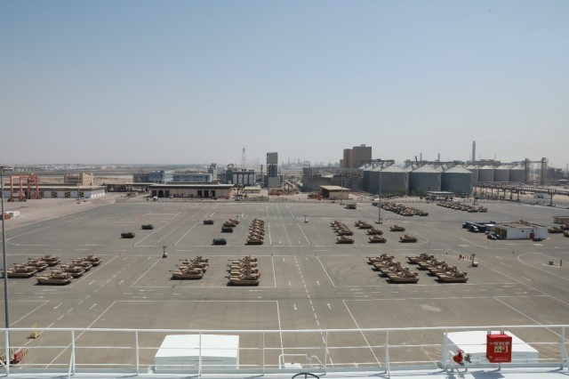 Aerial view from the Liberty Peace as military vehicles are downloaded and staged in preparation for transport to Kuwait at the industrial port at Yanbu, Kingdom of Saudi Arabia, April 20, 2021 as part of the logistics exercise, LOGEX 21. The cargo vessel carried rolling stock to include the M2/A2 Bradley Fighting Vehicle, Light Medium Tactical Vehicles (LMTV), and the High Mobility Multipurpose Wheeled Vehicle (HMMWV). LOGEX 21 demonstrates the 1st TSC's readiness and ability to provide responsive support to U.S. and partner nation forces from anywhere in the U.S. Central Command theater, exercising the Trans-Arabian Network.  (U.S. Army photo by Capt. Elizabeth Rogers)