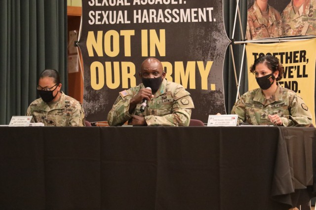 During the Women In Motion symposium at Camp Carroll, Republic of Korea, Command Sgt. LaDerek Green, command sergeant major, 19th Expeditionary Sustainment Command, speaks about his experience with developing open communications. Command Sgt. Maj. Pearl Reeder-Hensley, right, command sergeant major, 6th Ordnance Battalion; and Lt. Col. Romaine Aguon, commander, 498th Combat Support and Sustainment Battalion, also spoke at the symposium.