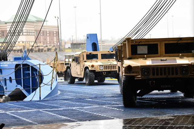 Stevedores at the Port of Beaumont drive military vehicles onto the M/V Resolve February 20, 2020 in support of DEFENDER-Europe 20. DEFENDER-Europe 20 was the first in a series of exercises the U.S. Army has planned in Europe and the Pacific over the next five years. (U.S. Army photo/Kimberly Spinner)