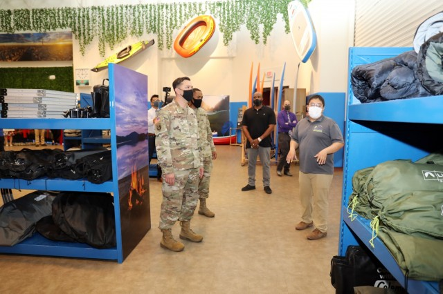 Col. Thomas Matelski, left, commander of U.S. Army Garrison Japan, and USAG Japan Command Sgt. Maj. Justin Turner tour the new Outdoor Recreation facility at Camp Zama, Japan, April 29. Hiro Huertas, right, Outdoor Recreation manager, briefs Matelski and Turner.