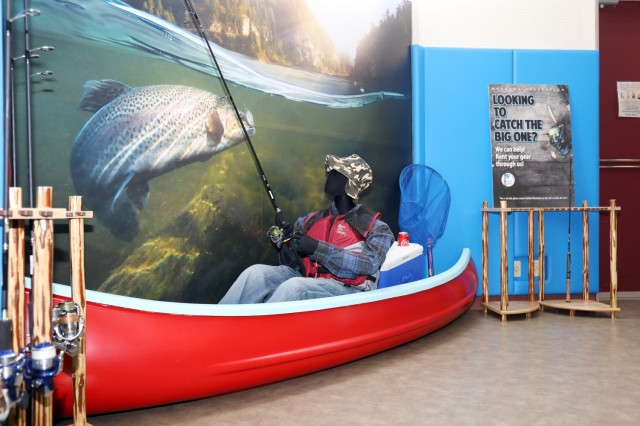 A life-sized fishing display stands inside the new Outdoor Recreation facility, Camp Zama, Japan, April 30. Kenji Osada, a Camp Zama Family and Morale, Welfare and Recreation maintenance employee, built it out of an old canoe.