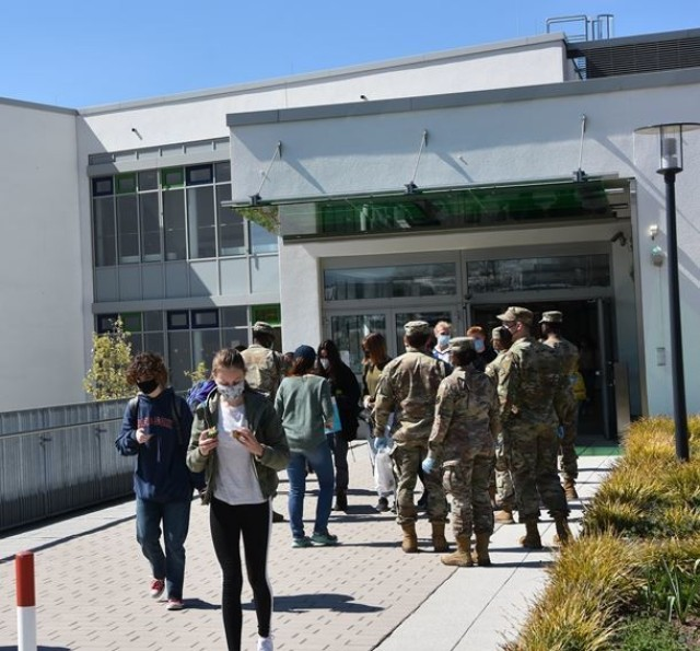 Soldiers with the 102nd Signal Battalion volunteered to salute students at Wiesbaden High School during Month of the Military Child April 23.