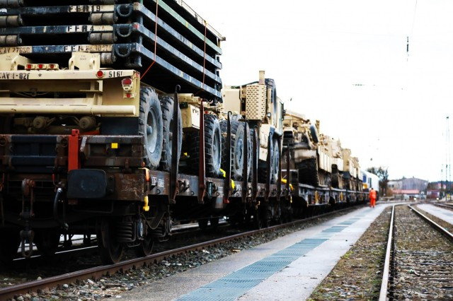 Armored vehicles assigned to the 1st Armored Brigade Combat Team, 1st Cavalry Division, sit on railcars at Parsburg, Germany, in preparation for transfer to Poland, Mar. 11, 2021.