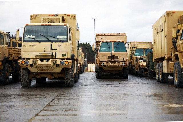 Vehicles assigned to the 1st Armored Brigade Combat Team, 1st Cavalry Division, are lined up at Hohenfels Training Area, Germany, in preparation for transfer to Poland, Mar. 11, 2021.