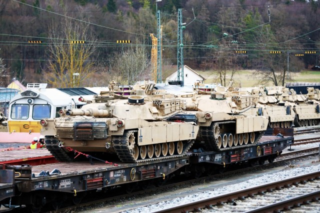 Two M1 Abrams Main Battle Tanks assigned to the 1st Armored Brigade Combat Team, 1st Cavalry Division, sit on railcars in preparation for transfer to Poland, at Parsburg, Germany, Mar. 13, 2021.