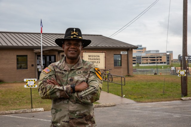 Capt. Raymond Akirewe, a chaplain with 1st Cavalry Division, poses outside the French Living Area at Fort Hood, Texas, April 4, 2021. Akirewe, an ordained Catholic priest, hails from Ghana, a francophone nation in west Africa. (U.S. Army photo by Sgt. Evan Ruchotzke)