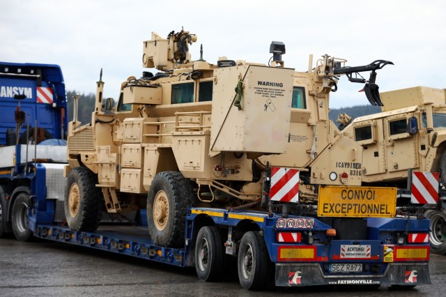 An armored vehicle assigned to the 1st Armored Brigade Combat Team, 1st Cavalry Division, sits on a flatbed trailer at Hohenfels Training Area, Germany, in preparation for transfer to Poland, Mar. 11, 2021.