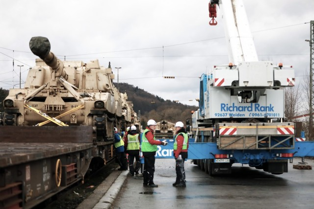 An M109 Paladin assigned to the 1st Armored Brigade Combat Team, 1st Cavalry Division, sits on a railcar in preparation for transfer to Poland at Parsburg, Germany, Mar. 11, 2021.