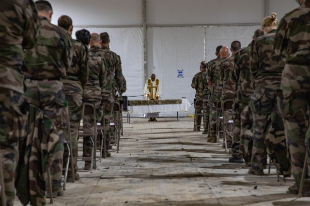 French Soldiers join together in prayer during a French-language Easter mass at Fort Hood, Texas, April 4, 2021. The date of Easter changes every year, falling on the first Sunday after the first full moon on or after the spring equinox. (U.S. Army photo by Sgt. Evan Ruchotzke)