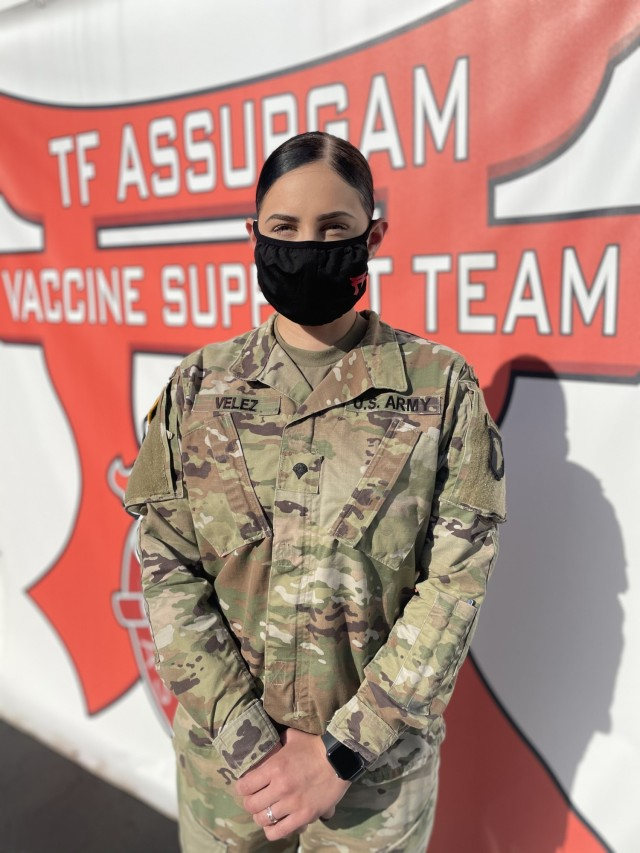 U.S. Army Spc. Larissa Lynn Velez, a water treatment specialist assigned to the 626th Brigade Support Battalion, poses for a portrait at the Community Vaccination Center at Valencia College – West Campus in Orlando, Florida, April 27, 2021. U.S. Northern Command, through U.S. Army North, remains committed to providing continued, flexible Department of Defense support to the Federal Emergency Management Agency as part of the whole-of-government response to COVID-19. (U.S. Air Force photo by Master Sgt Lakisha Croley/325th Fighter Wing, Public Affairs)