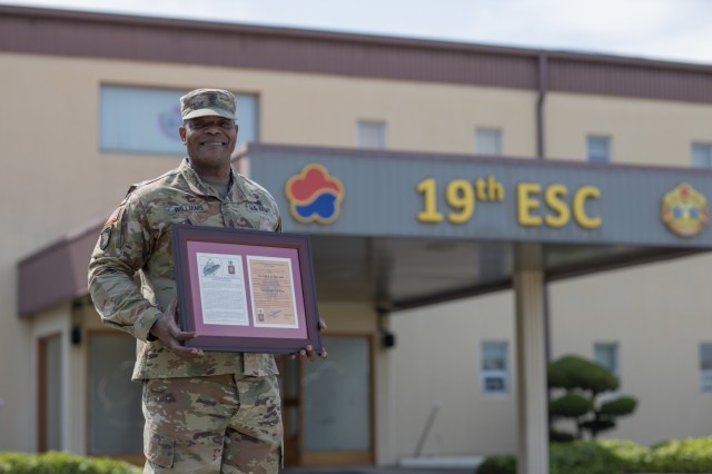 Command Sgt. Maj. AnDante' Williams received the Silver Spike Award for his 18 months of leadership at 25th Transportation Battalion.  Photo by PFC Kim, Jae Hyeong, 19th Expeditionary Sustainment Command
