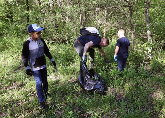 Local Cub Scout Pack 155 Scouts have been working toward their badges and awards by making the Fort Knox area a more picturesque place