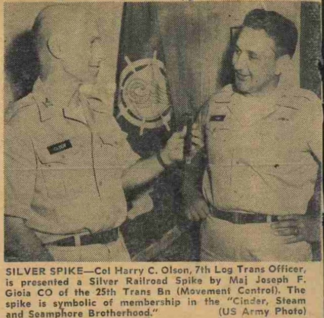 A historic photo with an estimated date of August 13, 1962, depicting the presentation of the Silver Spike Award from Maj. Joseph Gioia to Col. Harry Olson. The award has been a mainstay at the battalion, but was not presented since 2013 until it was bestowed upon Command Sgt. Maj. AnDante' Williams.