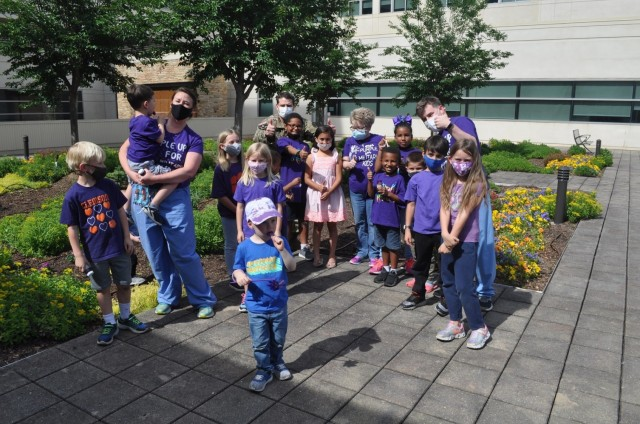Martin Army Community Hospital celebrates Month of the Military Child by having our youngest heroes plant purple flowers.