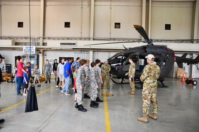 Leesville composite squadron, Civil Air Patrol, along with Family and friends, listen to pilots from the 1st Battalion, 5th Aviation Regiment, as they take a tour of the hangar, ask questions about flying helicopters and more April 27.