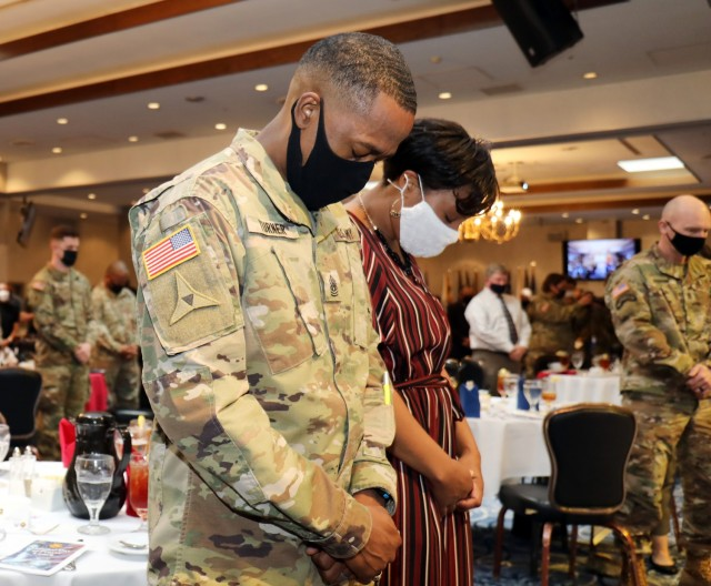 U.S. Army Garrison Japan Command Sgt. Maj. Justin Turner and his wife Royall  pray during the National Day of Prayer Lunch at the Camp Zama Community Club, Camp Zama, Japan, May 3.