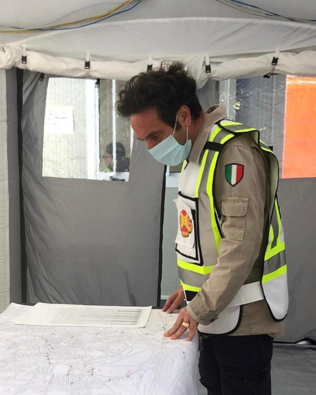 Host nation coordinator Antonio Quaglia reviews an evacuation map while supporting the U.S. Army Garrison operations' team from the Vicenza's emergency center May 2.  The garrison provided services to the 150 Americans forced to leave their homes when Italian officials evacuated downtown Vicenza for a daylong operation planned to defuse a World War II bomb.