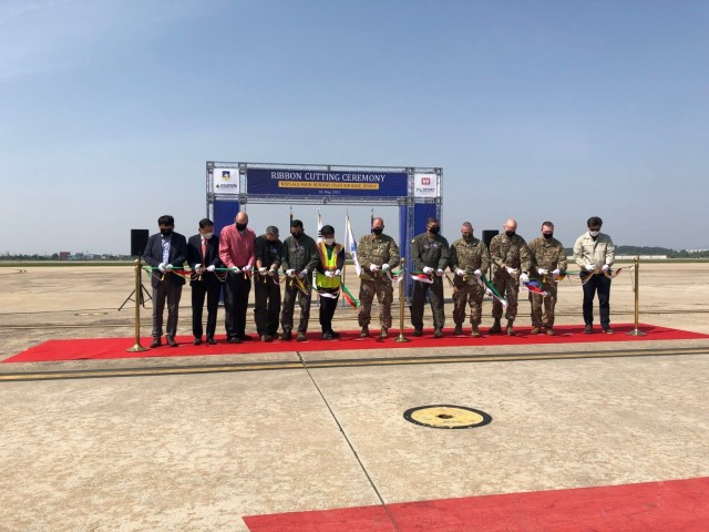 Col. Christopher Crary (Center) , U.S. Army Corps of Engineers (USACE), Far East District (FED) commander and Col. John Gonzales, 51st Fighter Wing commander, along with other dignitaries, conducted a ribbon cutting ceremony for the replacement of the main runway on Osan Air Base, Republic of Korea, May 3, 2021. This ceremony marks the completion of a 5-year, $75 million construction project to repair the main runway for Osan Air Base. (U.S. Army Photo)