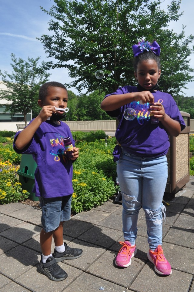 Nine-year-old Zimiah Olszak and her little brother blow bubbles as part of Martin Army Community Hospital's Month of the Military Child celebration.