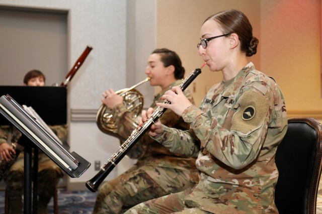 From right, Sgt. Lacey Semansky, Sgt. Caitlin Brody and Sgt. 1st Class Heather Harmon, members of the U.S. Army Japan Band's Fuji Winds woodwind quintet, play during the National Day of Prayer Lunch at the Camp Zama Community Club, Camp Zama, Japan, May 3.