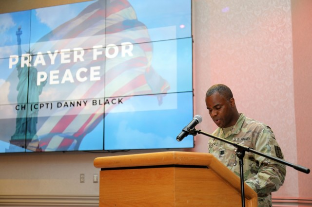 Chaplain (Capt.) Danny Black, chaplain for the 311th Military Intelligence Battalion, prays for peace during the National Day of Prayer Lunch at the Camp Zama Community Club, Camp Zama, Japan, May 3.