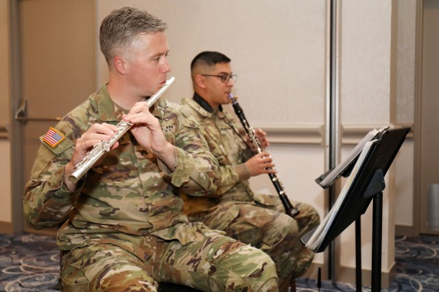 Sgt. Ryan MacDonald and Spc. Michael Zuniga, members of the U.S. Army Japan Band's Fuji Winds woodwind quintet, play during the National Day of Prayer Lunch at the Camp Zama Community Club, Camp Zama, Japan, May 3.