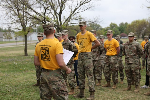 WICHITA, Kan. – Cadets of the Wichita State University Army Reserve Officer Training Corps listen to instructions and a safety briefing before starting out on their park clean-up community service project at Glen Dey Park April 28. Cadre of WSU ROTC – comprised entirely of Kansas Army National Guard members – and cadets train at the park regularly. They noticed the environment and the local community could benefit from the service project and decided to take action to improve conditions.