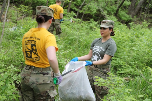 WICHITA, Kan. – Second-year Wichita State University Army Reserve Officer Training Corps cadet Alexandria Stegman, left, and first-year cadet Tammy Tran, right, both long-time Wichita residents, collect trash and debris at Glen Dey Park April 28. Cadre of WSU ROTC – comprised entirely of Kansas Army National Guard members – and cadets train at the park regularly. They noticed the environment and the local community could benefit from the service project and decided to take action to improve conditions.