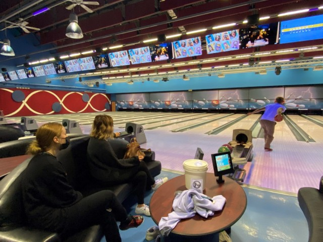 Kelly DeJardin (center) and her children enjoy family time at the bowling alley on Caserma Ederle May 2. The DeJardins are one of the 83 U.S. displaced families forced to leave their home when Italian officials evacuated downtown Vicenza to defuse a World War II bomb.