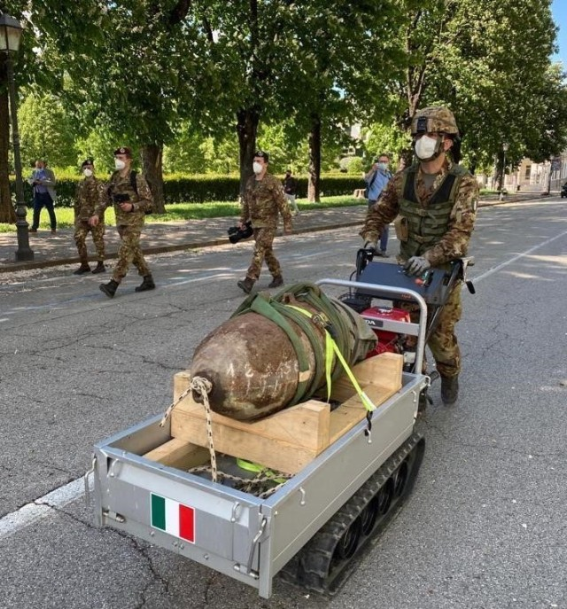 "Italian demolition experts with the 8th Regiment of the Folgore Airborne Engineers based in Legnago, Italy, disarmed a 500-pound British-made bomb that dropped 77 years ago on downtown Vicenza. In all, more than 3,100 local residents within 1,500 feet of the device were evacuated May 2. Among them were also 150 U.S. families forced to leave their homes for the daylong operation known to Italians as ""Bomba Day."""