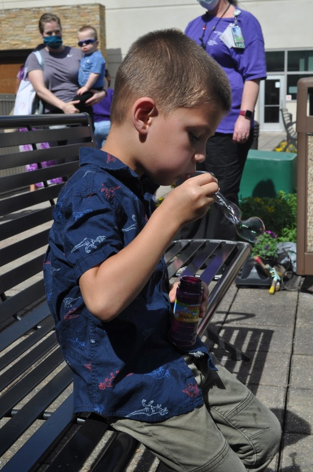 Five-year-old Cameron McDaniel blows bubbles as part of Martin Army Community Hospital's Month of the Military Child celebration.
