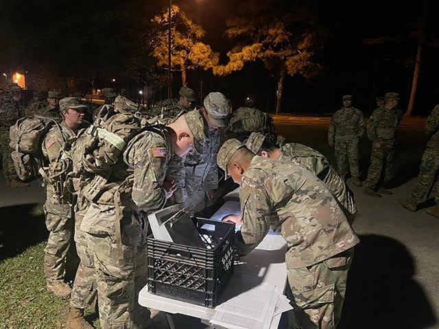 Soldiers sign in for the 18.6-mile road march held April 21 at Fort Polk's Warrior Hills Golf Course to earn their Norwegian Foot March badge.
