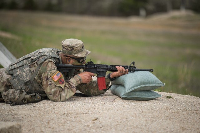 Staff Sgt. Marco Apodaca, competing in the NCO of the Year category, engages with targets during a rifle qualification event April 27 on Range 22.