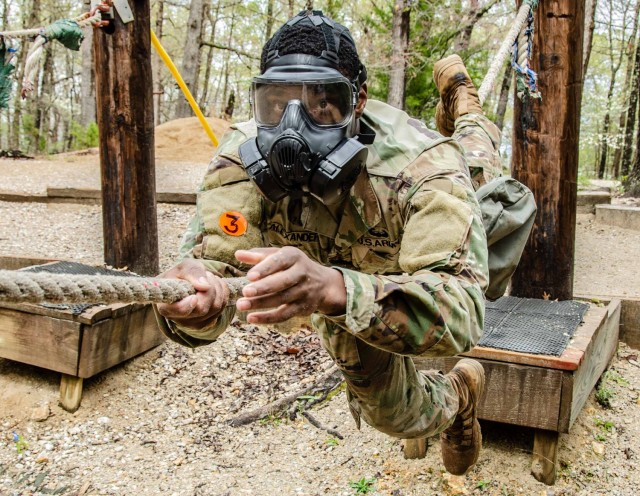 Staff Sgt. Aquai Alexander, Company A, 554th Engineer Battalion, competes at the Physical Endurance Course in a gas mask April 28. The addition of gas masks was a surprise element for the competitors. Alexander was named MSCoe Drill Sergeant of the Year.