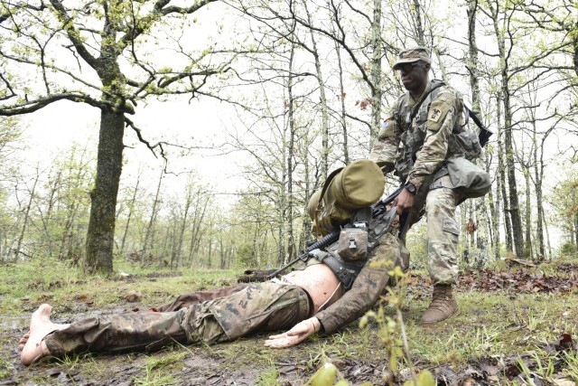 Sgt. 1st Class Curtis Hudson, Company B, 31st Engineer Battalion, performs a casualty extraction during the Expert Soldier Badge portion of the competition April 29 at Training Area 125.