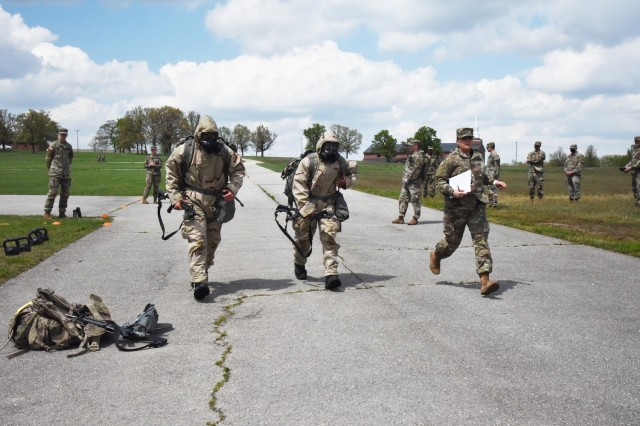 Competitors move as quickly as possible between stations during The Crucible event April 29 near Baker Theater. The event included many standards and soldiering skills from the Expert Soldier Badge certification.
