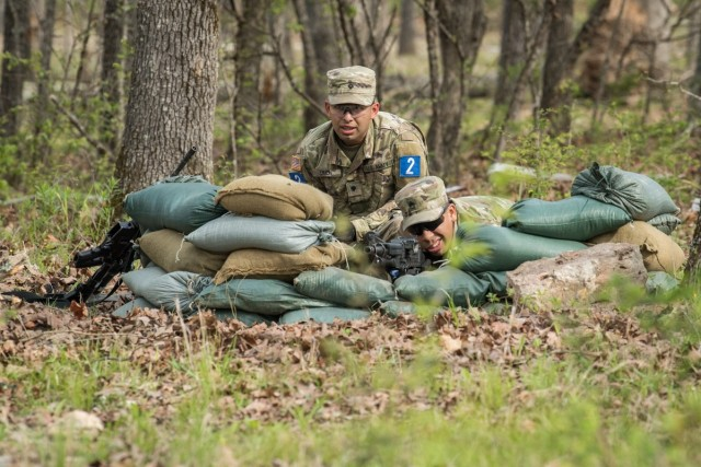 Staff Sgt. Christopher Aquirre (right) and Spc. Daneil Limon, representing 68th Chemical Company, engage a simulated enemy April 27 at Training Area 125.