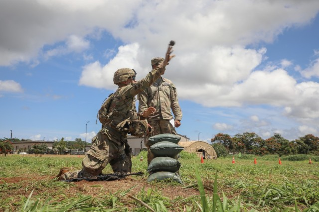 Pfc. Bryce Kossack, Company A, 1st Battalion, 21st Infantry Regiment, 25th Infantry Division, deploys a M-67 dummy grenade through a door on Schofield Barracks, Hawaii, April 27, 2021, for the Expert Soldier Badge/Expert Infantry Badge competition. The EIB/ESB is reserved for Soldiers possessing military occupational specialties of infantryman or special forces, while the Expert Soldier Badge is open to the remainder of Soldiers aside from medics and it tests Soldiers' abilities on basic soldiering skills in an intense competition.