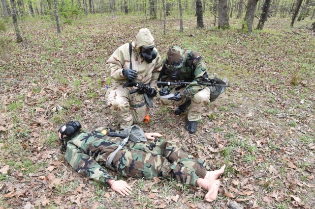 A team responds to a simulated casualty while patrolling during a chemical reaction lane April 27 at Training Area 125.