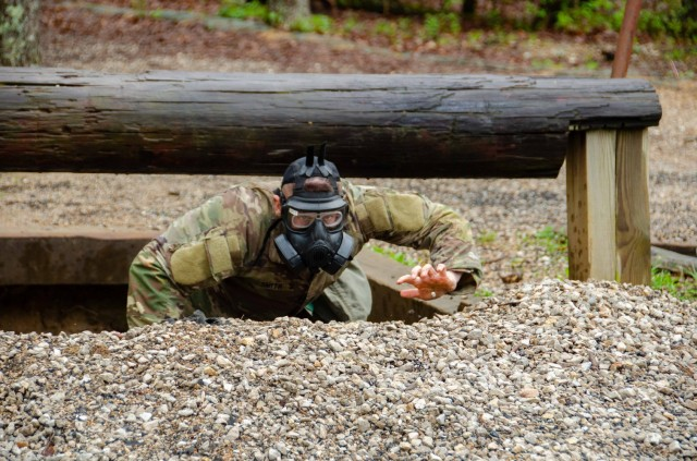 1st Lt. John-Wesley Smith, Company D, 795th Military Police Battalion, competes at the Physical Endurance Course in a gas mask April 28. Smith was named MSCoE Officer of the Year.