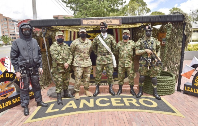 Command Sgt. Maj. Sean Rice, senior enlisted advisor at U.S. Army Security Assistance Command, poses for a photo with Colombian Lanceros (similar to Army Rangers) and senior enlisted leaders during day 4 of a key leader engagement with the Colombian Army at the Canton Norte base in Bogota, Colombia, 8 April 2021. CSM Rice joined Brig. Gen. Douglas Lowrey, USASAC commander, and members of his staff, as they visited several sites to see the impact of U.S. security assistance and foreign military sales, in support of the Colombian military in defending their country from counter-narcotic and terrorist threats. (U.S. Army photo by Richard Bumgardner)