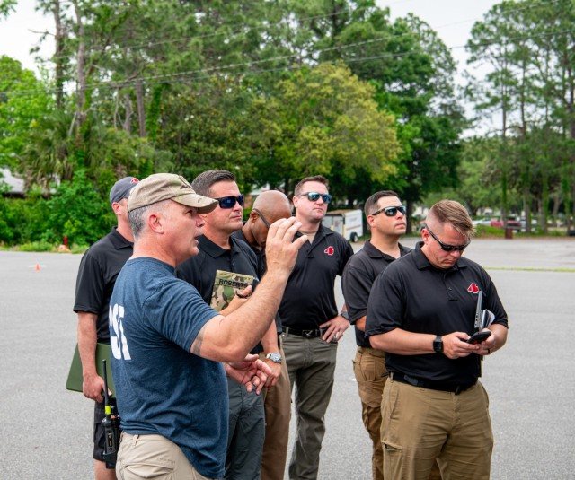 U.S. Army Lt. Col. Troy Eastman, commander of the 44th Civil Support Team conducts a relief-in-place brief with the incoming 4th CST from Atlanta, Georgia, during a multi-CST training exercise in Fort Walton Beach, Tuesday, May 4.