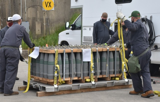 Blue Grass Chemical Activity personnel strap the last of the VX projectiles onto a tray for loading into an enhanced on-site container.