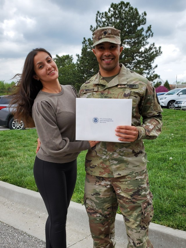 """Spc. Ahmed Amine Bennani, an emergency room medic at Fort Riley's Irwin Army Community Hospital became a citizen during an April 28 naturalization ceremony in Kansas City. His wife Veronica Godinez went through the naturalization process about four years earlier. Godinez is from Guatemala. Bennani is from Morocco. The two met and married in Boston and now both are American citizens. """"I'm very happy,"""" said Godinez. """"Sometimes when you are from another country, you feel this is your country. This is like them telling you, 'Yes, this is your country' and no one can let you go. He's fighting for his country, working for his country, facing everything for his country, because this is his country now. And now he can say proudly, 'I am American.'"""""""